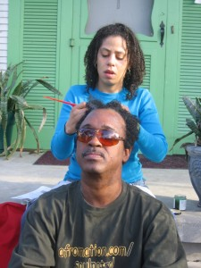 Najma Nazyat braiding Michael Woods' hair at Recovery Camp Dorgenois