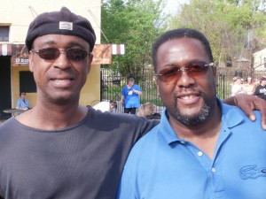 Michael Woods & Wendell Pierce on Esplanade Ave. watching the Crescent City Classic participants run by