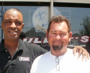 Michael Woods & Rollin Garcia (aka Bullet) in front of Bullet's Sports Bar in the 7th Ward