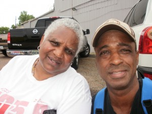 Jenifer Turner & Michael Woods in front of Community Book Center during JazzFest